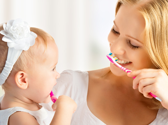 mother and child brush teeth family dentistry at penerley road dental practice