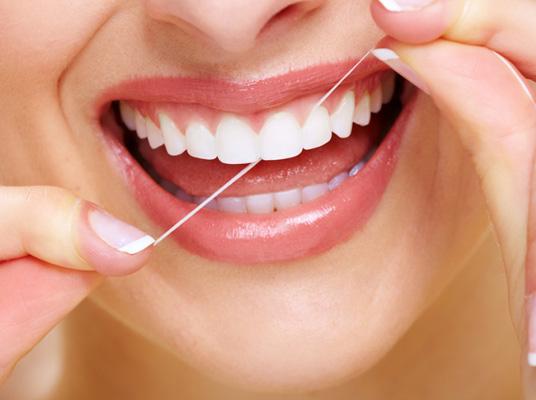 womans flosses teeth penerley road