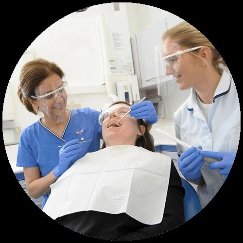 maryam jahangiri giving a patient a check up at penerley road dental surgery